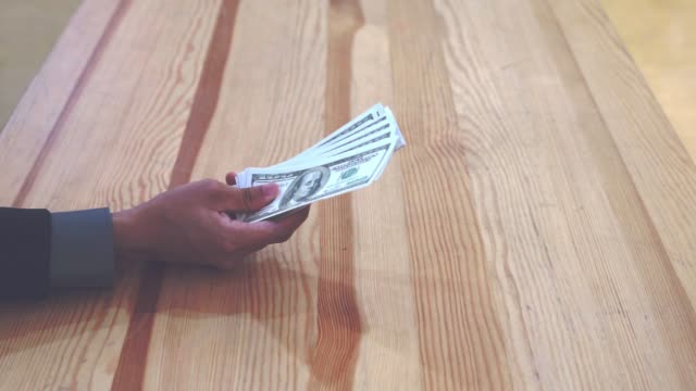 close up hand of business man reject stag of money from another person - indennità video stock e b–roll