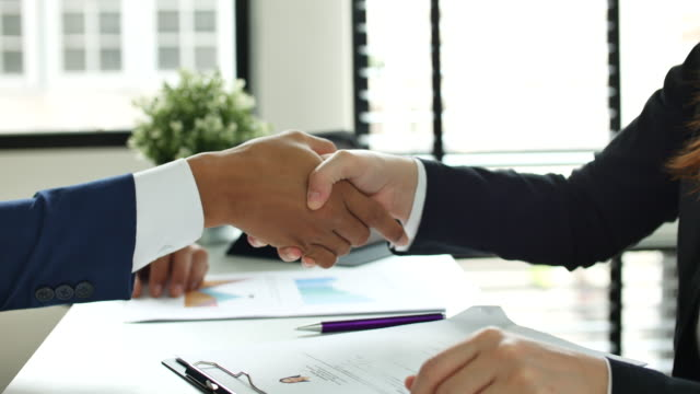 Close up Hand of Business people meeting a job interview in the office and Handshake Dolly shot Close up Hand of Business people meeting a job interview in the office and Handshake for agreement. Close up and side view composition. job interview stock videos & royalty-free footage