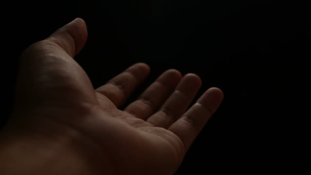 Close up Hand of homeless isolated on back background. Concept of give donate charity finance and grant.