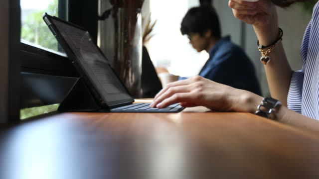 close up hand of southeast asia woman typing computer in cafe video