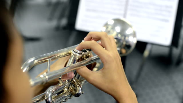 close up hand of young trumpet player video