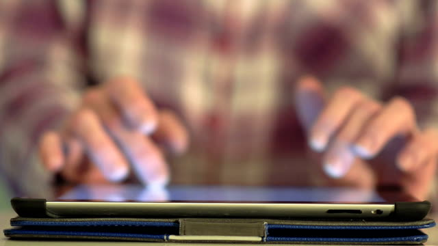 Close Up Hand Typing On Tablet Computer Touch Screen video
