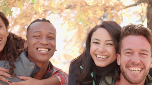 Close up handheld pan of three couples piggybacking outdoors Close up handheld pan of three couples piggybacking outdoors mixed race person stock videos & royalty-free footage
