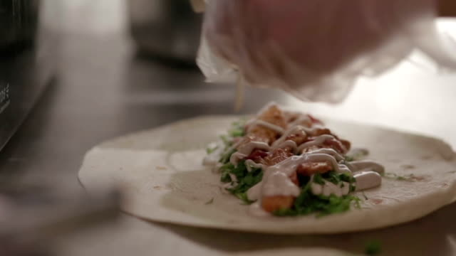 close up hard of chef cooking or prepare kebab food with vegetable and sauce - spiedino video stock e b–roll