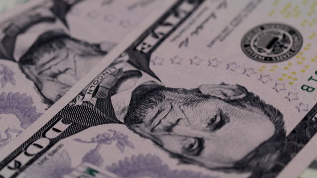 Close up heap of dollars, selective focus. Dollars, the us money background, 4K movie. video