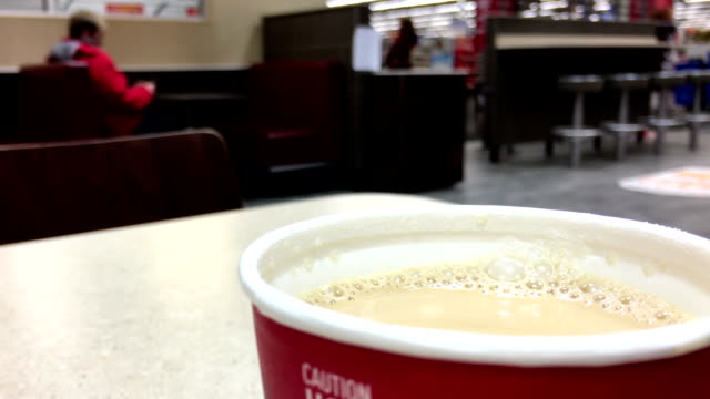 Close up hot Mccafe coffee at mcdonalds fast food restaurant video