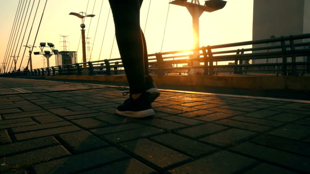 Close up human leg walking on a bridge with sunlight Close up human leg walking on a bridge with sunlight dawn stock videos & royalty-free footage