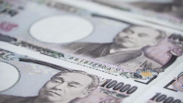 日本の通貨円貨紙幣をクローズアップ。 - 紙幣点の映像素材/bロール