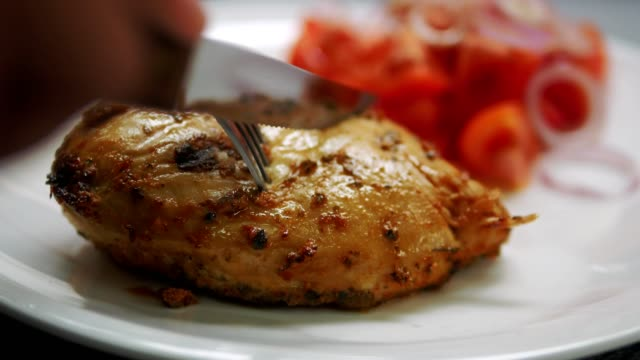 Close up knife cutting chicken steak on white plate Close up knife cutting chicken steak on white plate fillet stock videos & royalty-free footage
