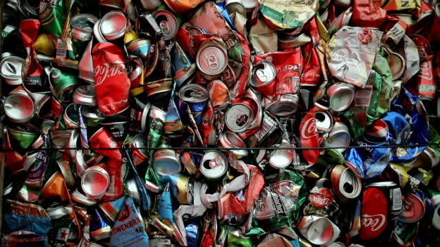 close up large number of aluminum drinks cans for recycling.recycled crushed tin can bale stacks - zgnieciony filmów i materiałów b-roll