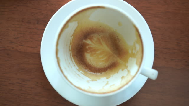 Close up latte art  of coffee after eaten on table