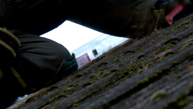 Close up look of the roofer getting off the nails video