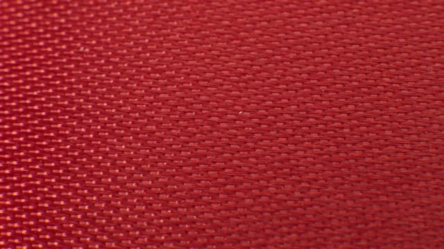 close up macro red ribbon fabric texture. textile background pattern - tappeto video stock e b–roll