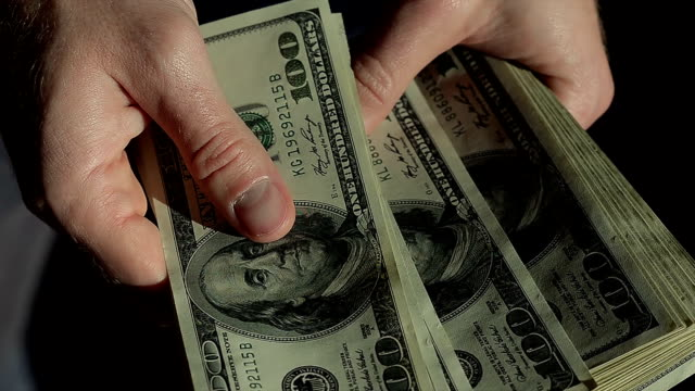 Close Up Male Hands Count Hundred Dollar Bills in the Dark video