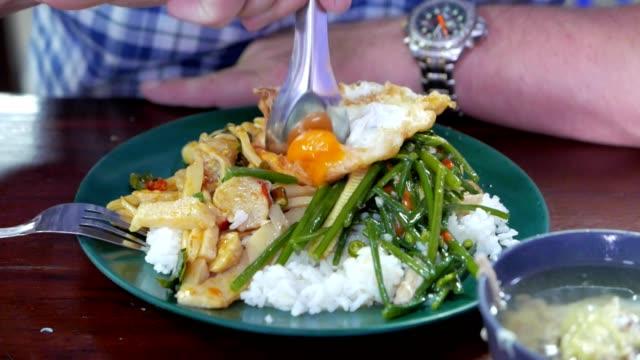 Close up man hand eating Thai food