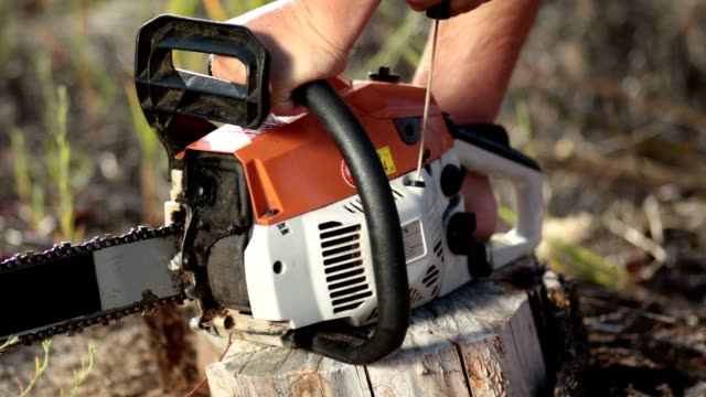 Close up man hands starting chainsaw video