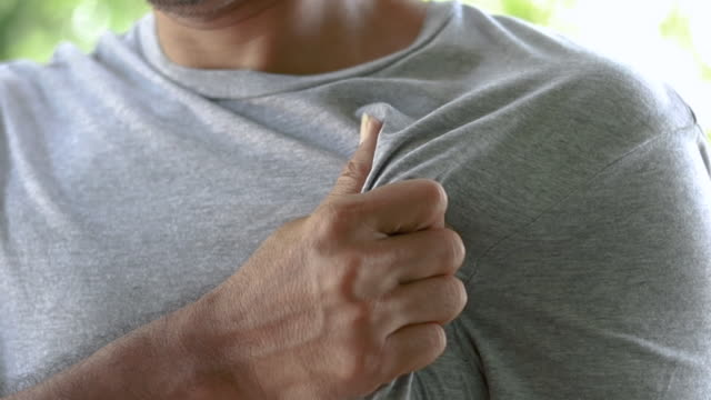 close up man having chest pain, health care concept - torace umano video stock e b–roll