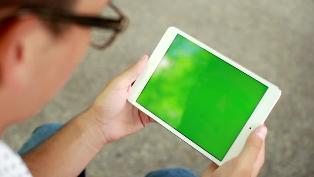 close up man holding blank tablet pc with green screen - tablet stock videos and b-roll footage