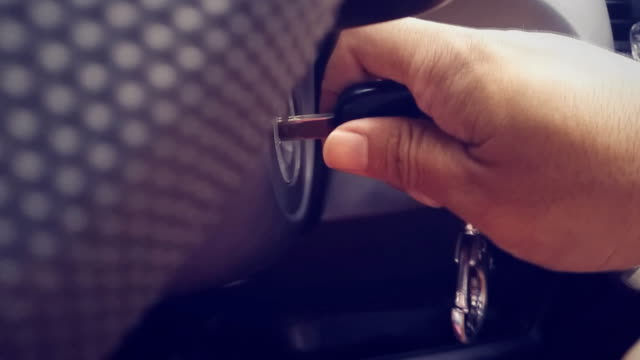Close up man inserting key into car to start. Close up man inserting key into car to start. car key stock videos & royalty-free footage
