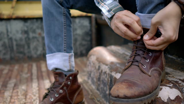 Close up, Man Tying Shoelaces video