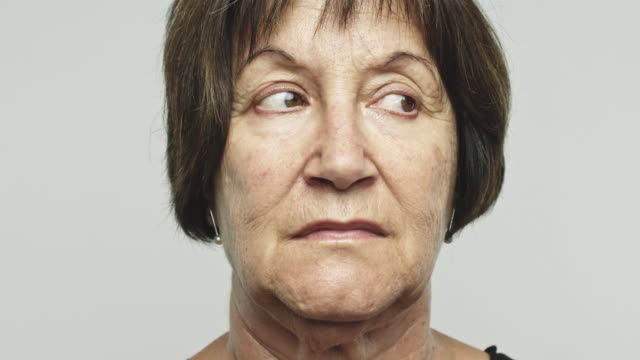 Close up mature woman looking around video