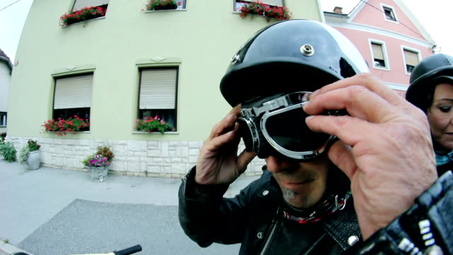 HD: Close up motorcycle driver putting on protection glasses video