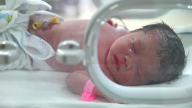 Close up newborn in nursery after childbirth video