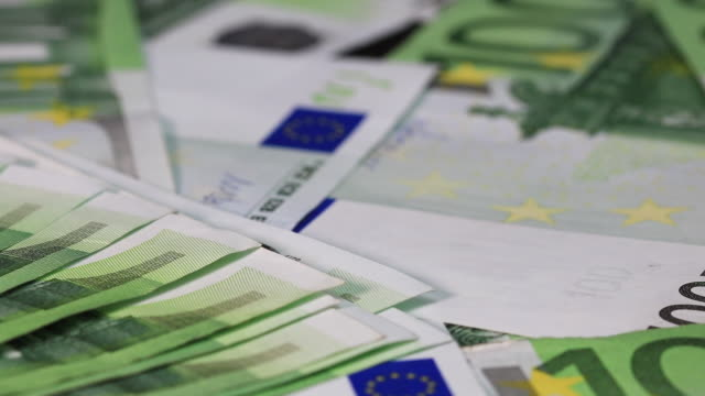 Close up of 100 EURO money banknotes. Background with money EURO bills. Cash money background
