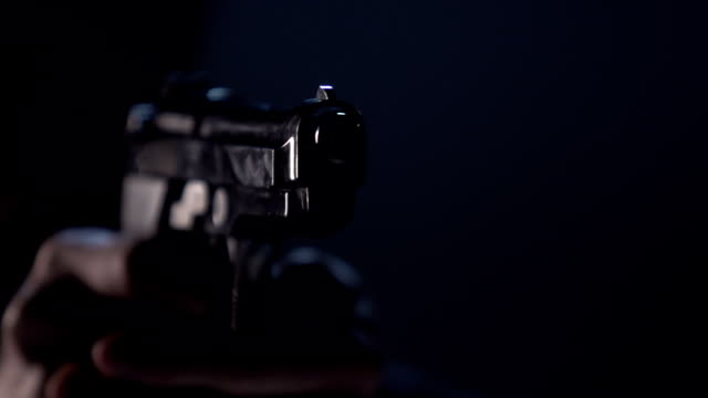 stockvideo's en b-roll-footage met close up of 9 mm handgun. shooter takes three shots - gun shooting