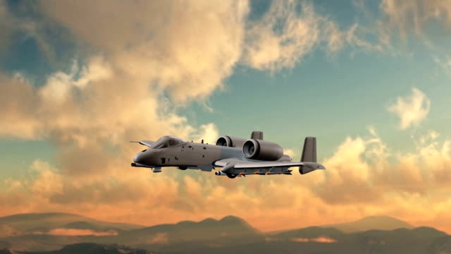 close up of a armed Thunderbolt military ground attack aircraft in flight video
