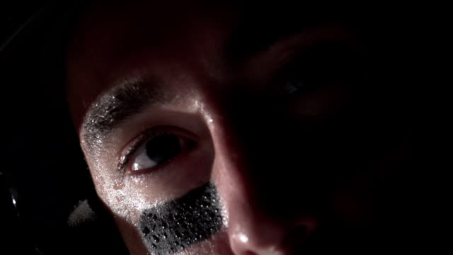Close up of a baseball players eyes as he bats video