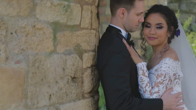 Close up of a beautiful wedding couple in park video