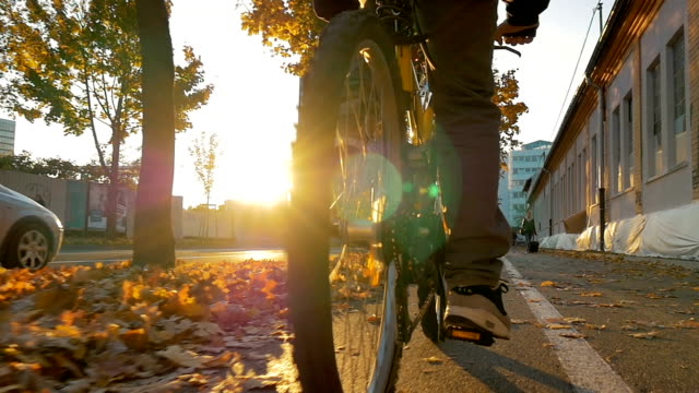 Close up of a biker riding trugh city in sunset video