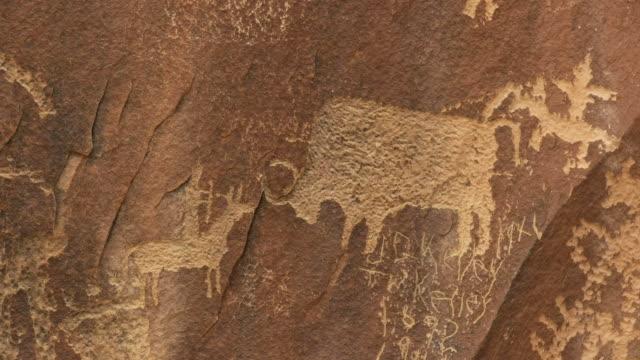 close up of a bison hunting scene on newspaper rock, utah