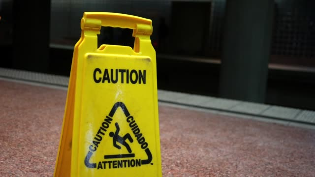 Close up of a caution sign near the train tracks of a subway station video