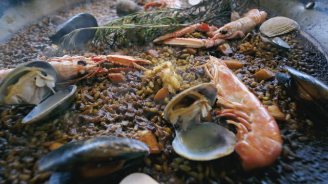 close up of a delicious and hot paella. - seafood stock videos and b-roll footage