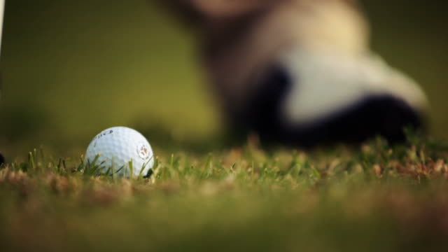 Close up of a golf ball being played video