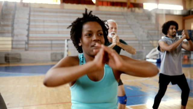 Close up of a group of people doing exercise at aerobic class