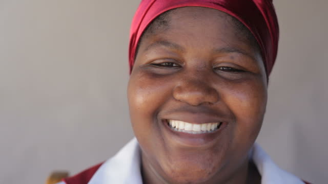 Close up of a happy african woman with big smile video