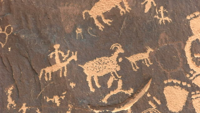 close up of a human figure hunting sheep on newspaper rock, utah