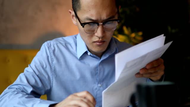 Close up of a man calculating his financial bills