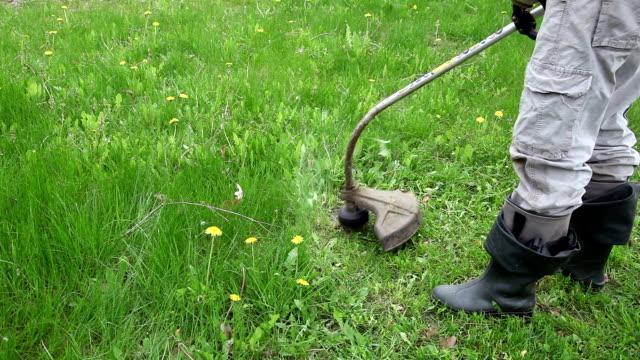 Close up of a man cutting grass video