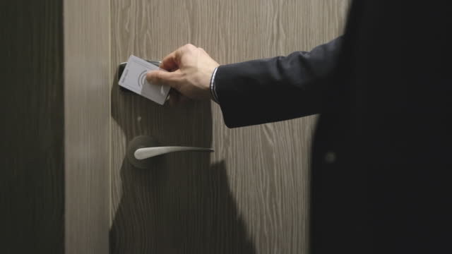 Close up of a man swiping the card to enter his hotel room video