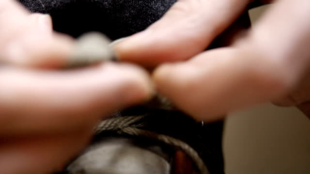 Close up of a man tying his work boots video