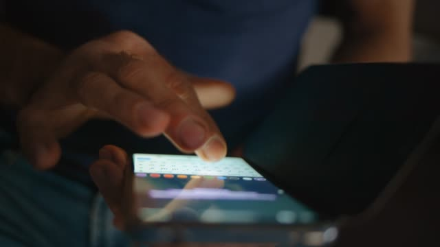 Close up of a man using mobile smart phone video