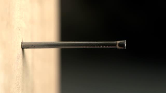 close up of a nail being hammered into wood - hammare bildbanksvideor och videomaterial från bakom kulisserna