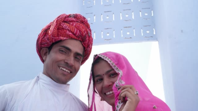 97ba2b24ff Close up of a newly fresh married Indian couple in ethnic attire posing for  photo and
