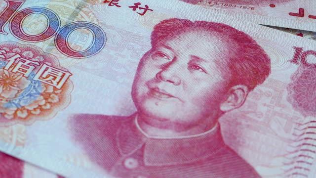Close up of a rotating 100 Chinese Yuan banknote, 4k Resolution. Close up of a rotating 100 Chinese Yuan banknote, 4k Resolution. china east asia stock videos & royalty-free footage