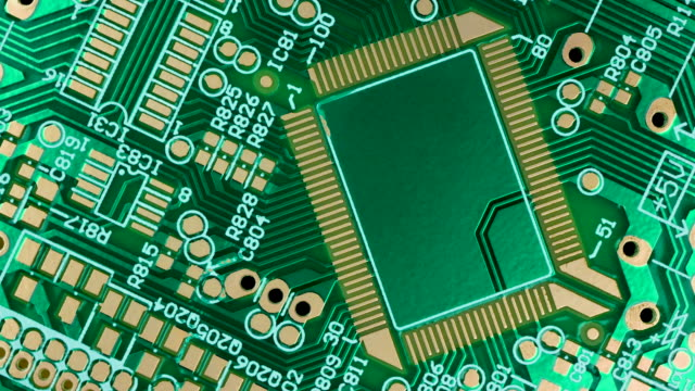 Close up of a rotating Electronic circuit chip on PC board, 4k Resolution.