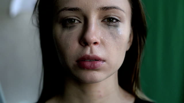 close up of a scared and crying woman with smeared make up - domestic violence stock videos & royalty-free footage